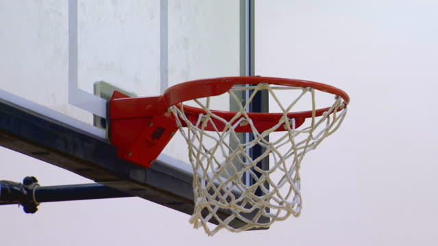 Basketball hoop in gym, shots made and missed