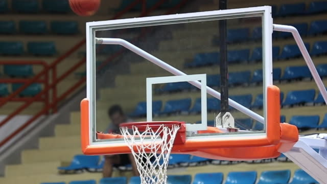 basketball into hoop, slow motion - shooting baskets stock videos and b-roll footage