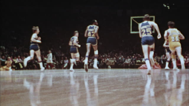 vídeos de stock, filmes e b-roll de ms, cu, composite, basketball match,1970's, los angeles, california, usa - 1973