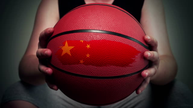 basketball painted with chinese flag - chinese flag stock videos and b-roll footage