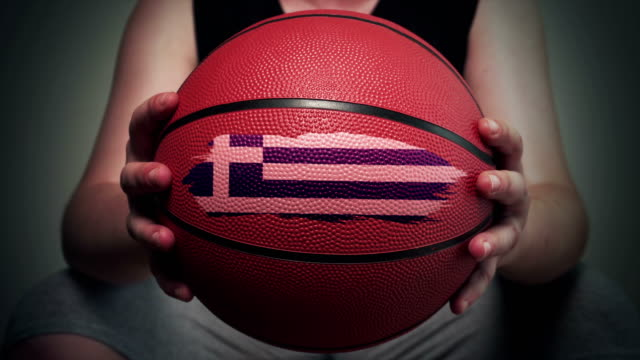 basketball painted with greek flag - greek flag stock videos & royalty-free footage