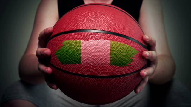 basketball painted with nigerian flag - nigerian flag stock videos & royalty-free footage