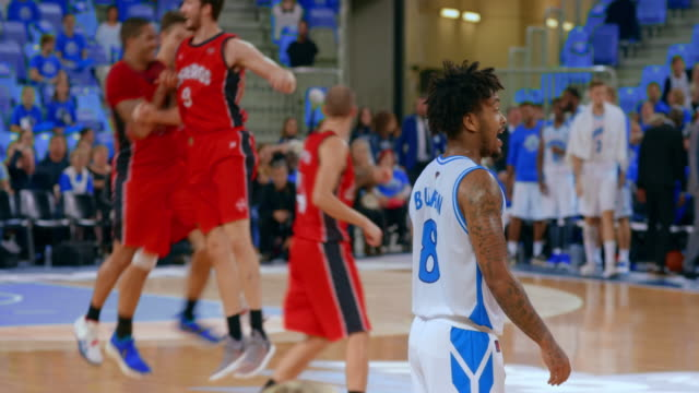 basketball player doing the jump shot and the team celebrates - basketball player stock videos & royalty-free footage