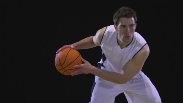 ms slo mo basketball player dribbling basketball / berlin, germany - バスケットボールのボール点の映像素材/bロール
