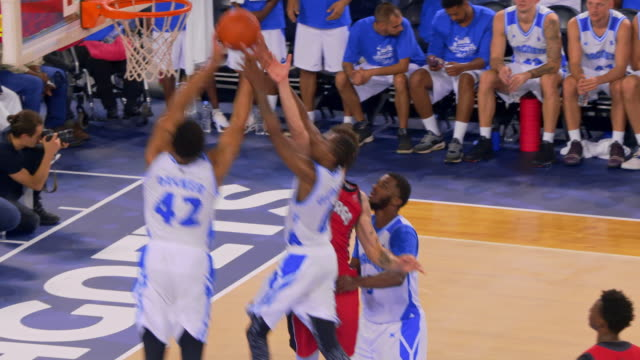 basketball player dunking the ball in the game - basketball player stock videos & royalty-free footage