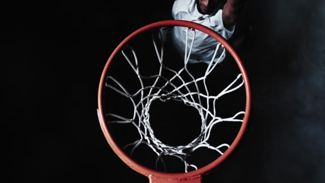 SLO MO of basketball player dunking the ball