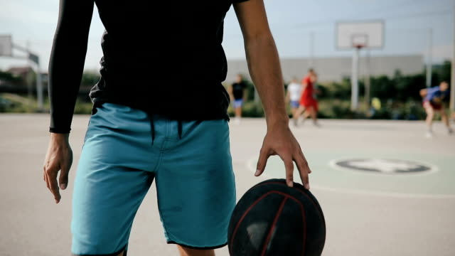 Basketball player exercising on basketball court.