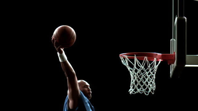 sm me basketball player flying through air and dunking ball in net/ auckland, new zealand - 20 24歳点の映像素材/bロール