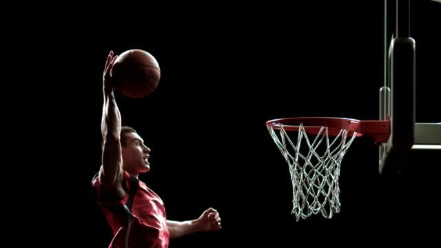 vídeos y material grabado en eventos de stock de sm ms basketball player grabbing ball in mid-air and dunking it in basket/ auckland, new zealand - canasta de baloncesto