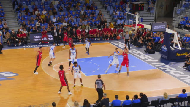 basketball player in red jersey scoring a bank shot - shooting baskets stock videos & royalty-free footage