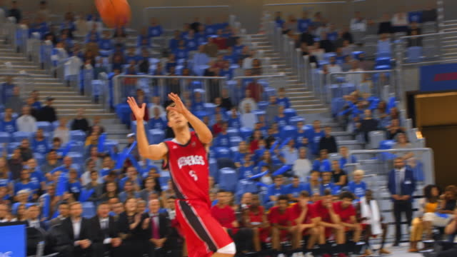 basketball player in red jersey scoring a slam dunk - drive ball sports stock videos & royalty-free footage