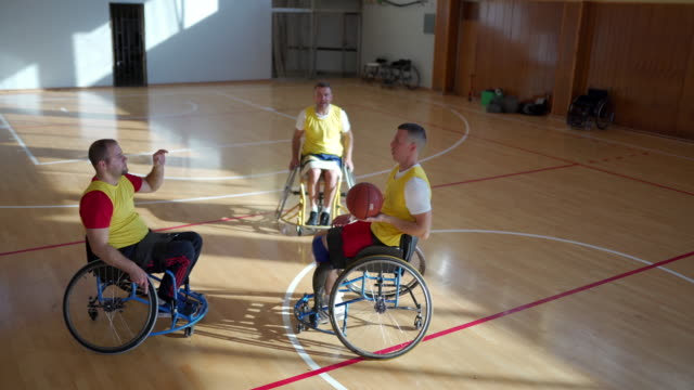 basketball player in wheelchair throwing ball - wheelchair basketball stock videos & royalty-free footage