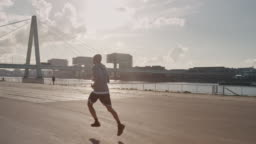 Basketball player jogging in city on sunny day