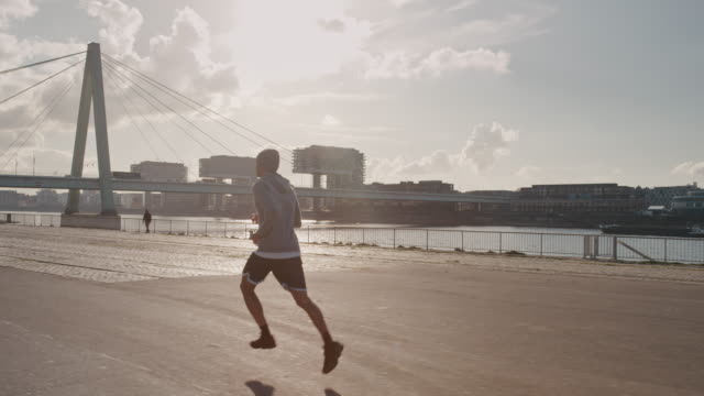 basketball player jogging in city on sunny day - jogging stock videos & royalty-free footage