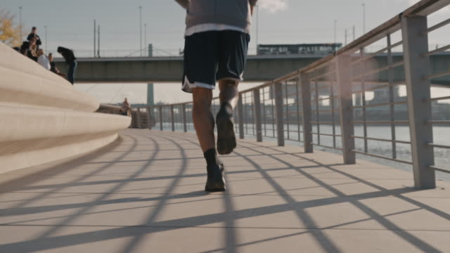 basketball player jogging on promenade in city - promenade stock videos & royalty-free footage