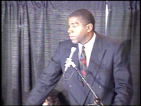 / basketball player magic johnson at press conference announcing that he is hiv positive and will be retiring from the la lakers magic johnson makes... - magic johnson stock videos and b-roll footage