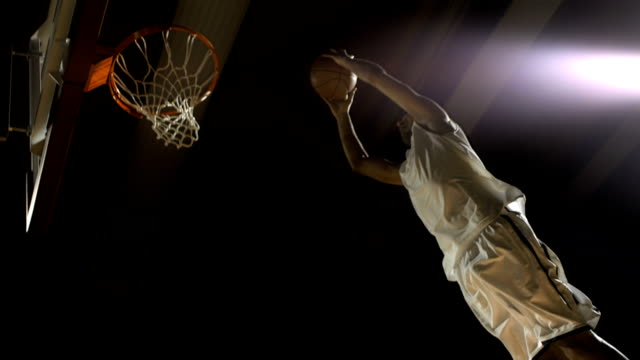 basketball player performs a slam dunk (super slow motion) - basketball ball stock videos & royalty-free footage