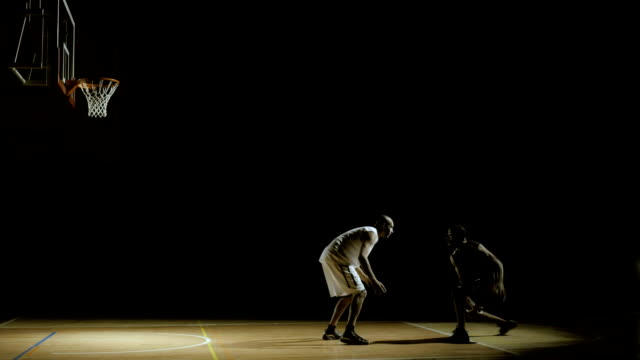 basketball player performs dribbling penetration - defending stock videos & royalty-free footage