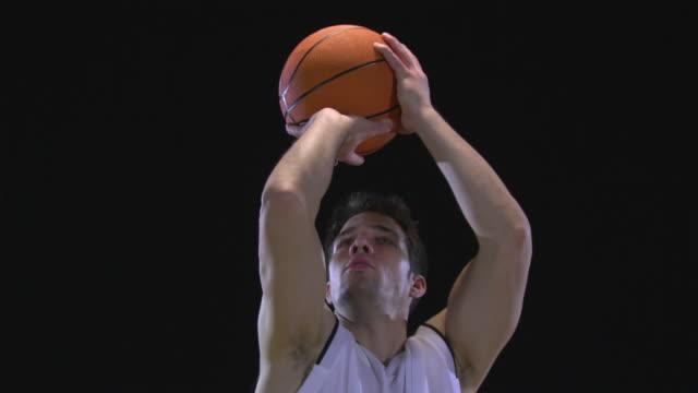 cu slo mo basketball player playing basketball / berlin, germany - スタジオ撮影点の映像素材/bロール