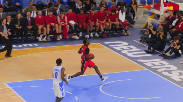 basketball player scoring a bank shot - wooden floor stock videos & royalty-free footage