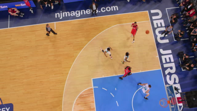aerial basketball player scoring a jump shot in the game - non us film location stock videos & royalty-free footage