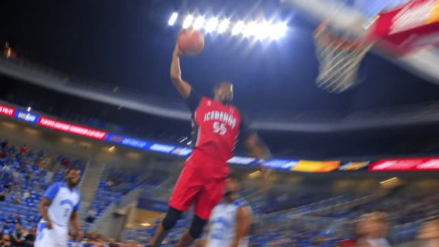 Basketball player scoring a slam dunk