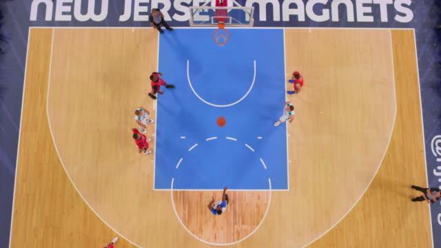 stockvideo's en b-roll-footage met aerial basketball player scoring from the free throw line - buiten de vs