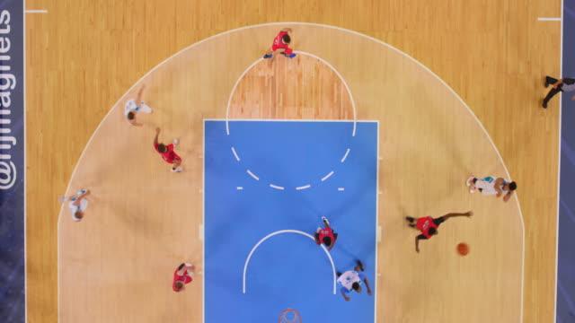aerial basketball player scoring points from the white team - 非在美國拍攝 個影片檔及 b 捲影像