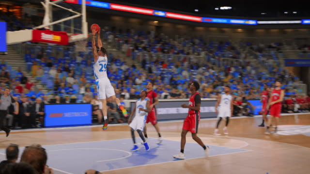 basketball player scoring with a slam dunk during a game - basketball ball stock videos & royalty-free footage
