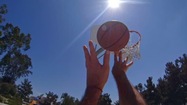 vídeos de stock e filmes b-roll de basketball player pov - shot off the backboard and nothing but net! - perspetiva pessoal