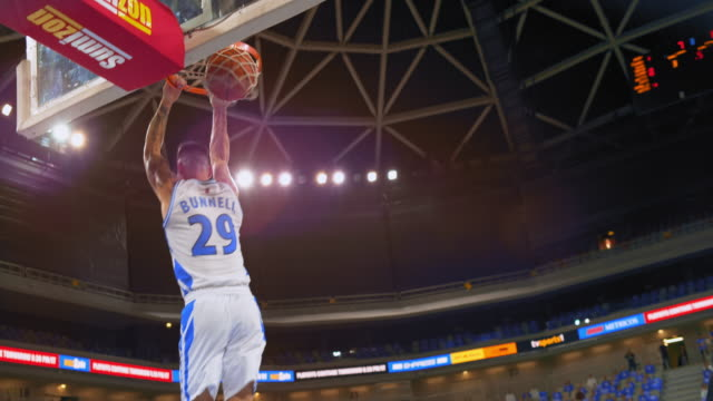 slo mo basketball player slam dunking backwards into the hoop - shooting baskets stock videos & royalty-free footage