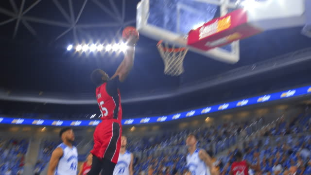 basketball player slam dunking the ball - basketball player stock videos & royalty-free footage