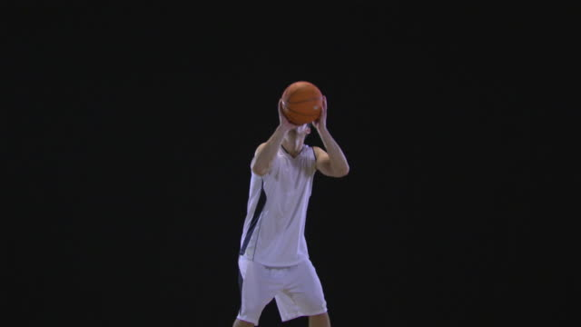 ws slo mo basketball player taking shot and clenching fist / berlin, germany - スタジオ撮影点の映像素材/bロール