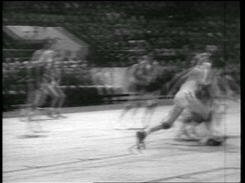 pan basketball player tripping to get ball / team scores / toronto huskies vs ny knicks - 1946 stock videos and b-roll footage