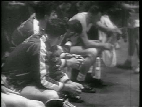 b/w 1946 basketball players sitting on bench / toronto huskies vs ny knicks game - 1946 stock videos and b-roll footage