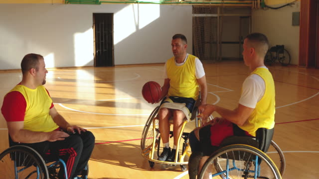 basketball players with couch at para basketball practice - wheelchair basketball stock videos & royalty-free footage