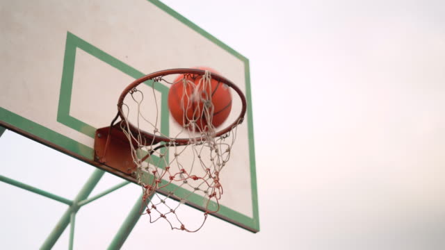a basketball shot swishes through the net - shooting baskets stock videos & royalty-free footage
