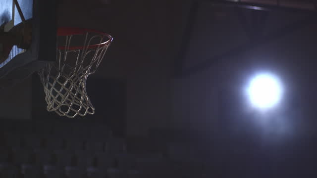 A basketball swishes into the net.
