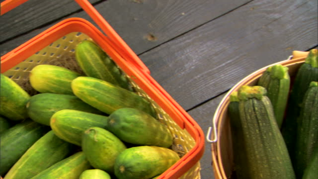 baskets of fresh organic produce - courgette stock videos and b-roll footage