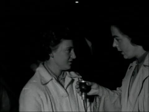 survivors return to uk england london victoria station int catholic pilgrims along platform woman along with head wrapped in bandage young woman... - 1957 bildbanksvideor och videomaterial från bakom kulisserna