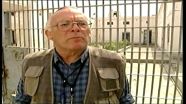 british run prison opens doors to cameras itn iraq basra garetn davies interview sot talks of being disgusted by scenes from abu ghraib prison int... - basra stock videos and b-roll footage