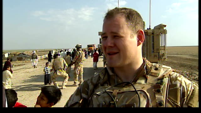 british troop patrols in marsh arab areas flight lieutenant ed cripps interview sot women and youths fighting over goods handed out by british troops - marsh stock videos & royalty-free footage