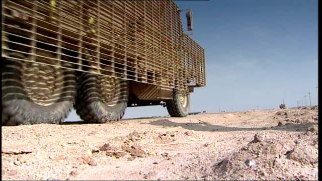 british troop patrols in marsh arab areas iraq basra ext british troops patrolling road in amoured vehicles - marsh stock videos & royalty-free footage