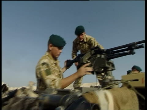 vídeos y material grabado en eventos de stock de british royal marines cleaning and checking rifles ms side officer looking on as marines assemble gun atop armoured vehicle ms marines checking gun... - basra