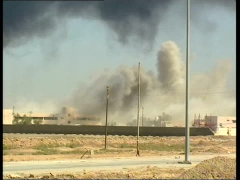 basra ext tank stationed at side of road as thick cloud of black smoke rises in b/g black smoke rising from oil field trenches lit by iraqis bv tank... - iraq stock videos and b-roll footage