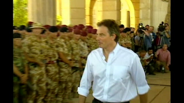 basra: int tony blair mp along past british troops during visit blair making speech during visit - basra video stock e b–roll