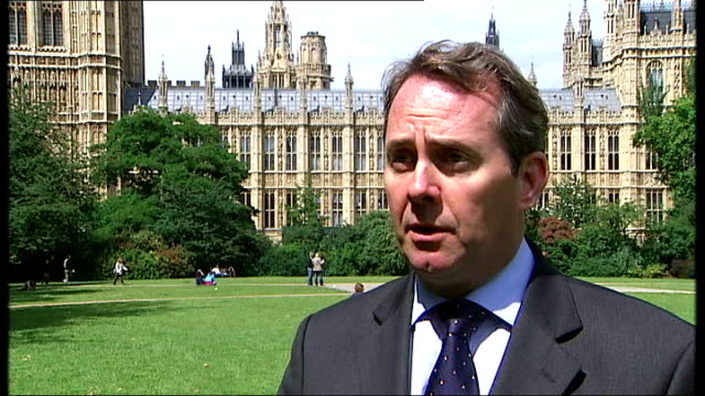 three british soldiers killed england london westminster ext liam fox mp interview sot - basra stock-videos und b-roll-filmmaterial