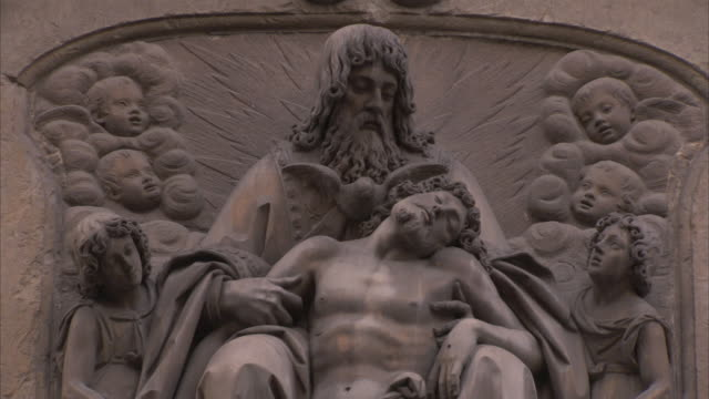 a bas-relief depicts a man holding another man slumped in the former's lap. - bas relief stock videos & royalty-free footage