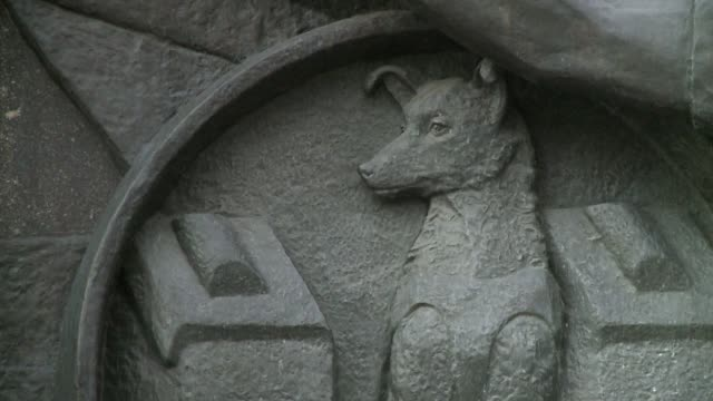a bas-relief image of a dog adorns the monument to the conquerors of space in moscow. available in hd. - monument stock videos & royalty-free footage