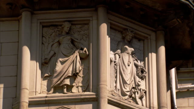 bas-relief images decorate the facade of the manchester town hall in england. available in hd. - rathaus stock-videos und b-roll-filmmaterial